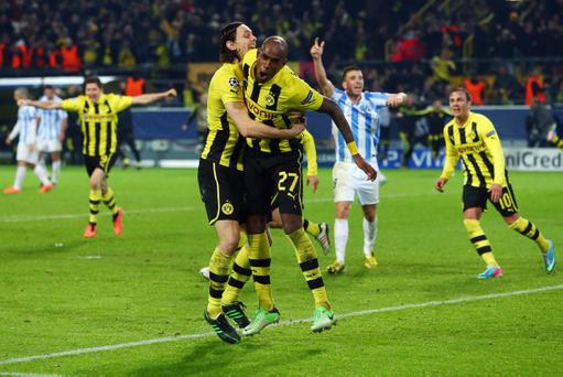 DORTMUND, GERMANY - APRIL 09: Felipe Santana (R) of Borussia Dortmund celebrates scoring their third and winning goal with team mates Neven Subotic during the UEFA Champions League Quarter Final second leg match between Borussia Dortmund and Malaga at Signal Iduna Park on April 9, 2013 in Dortmund, Germany. (Photo by Alex Grimm/Bongarts/Getty Images)
