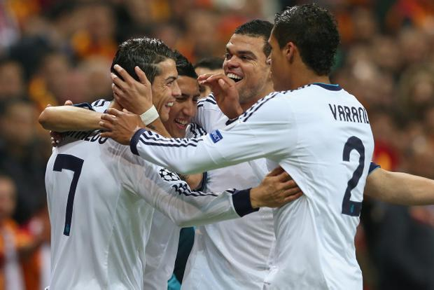 ISTANBUL, TURKEY - APRIL 09: Cristiano Ronaldo (L) of Real Madrid celebrates scoring the opening goal with Pepe and Angel Di Maria during the UEFA Champions League Quarter Final match between Galatasaray AS and Real Madrid at the Turk Telekom Arena on April 9, 2013 in Istanbul, Turkey. (Photo by Alex Livesey/Getty Images)