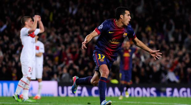 Pedro of Barcelona celebrates scoring during the UEFA Champions League quarter-final second leg match between Barcelona and Paris St Germain at Nou Camp on April 10
