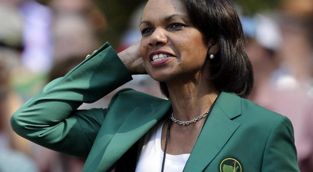 Former Secretary of State Condoleezza Rice watches the par three competition before the Masters golf tournament Wednesday, April 10, 2013, in Augusta, Ga. (AP Photo/Charlie Riedel)