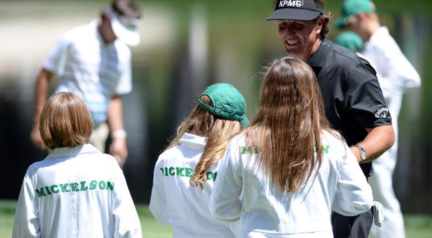 AUGUSTA, GA - APRIL 10: Phil Mickelson of the United States celerates with is children during the Par 3 Contest prior to the start of the 2013 Masters Tournament at Augusta National Golf Club on April 10, 2013 in Augusta, Georgia. (Photo by Harry How/Getty Images)