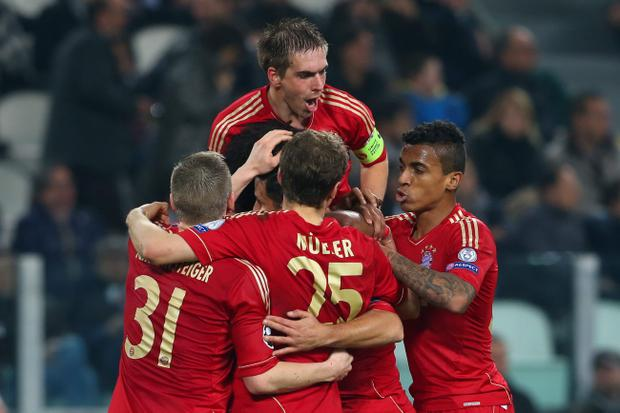 TURIN, ITALY - APRIL 10: Philipp Lahm (top) of Munich celebrates the second team goal with his team mates during the UEFA Champions League quarter-final second leg match between Juventus and FC Bayern Muenchen at Juventus Stadium on April 10, 2013 in Turin, Italy. (Photo by Alexander Hassenstein/Bongarts/Getty Images)