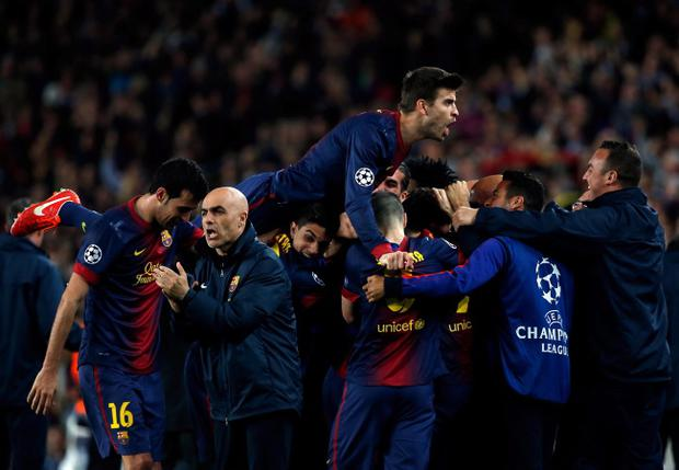 Barcelona players celebrate after scoring their first goal during the Champions League quarterfinal second leg soccer match between FC Barcelona and Paris Saint-Germain FC at the Camp Nou stadium in Barcelona, Spain, Wednesday, April 10, 2013. (AP Photo/Emilio Morenatti)