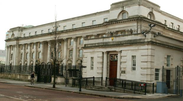 Pizza delivery driver allegedly caught with a sawn-off shotgun said he bought it to scare off paramilitaries threatening him, court hears