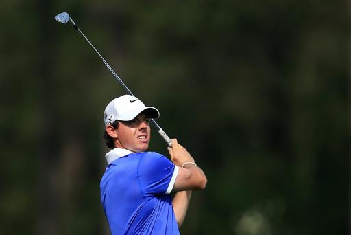 Rory McIlroy tees off on the 12th hole during the first round of the 2013 Masters at Augusta National Golf Club