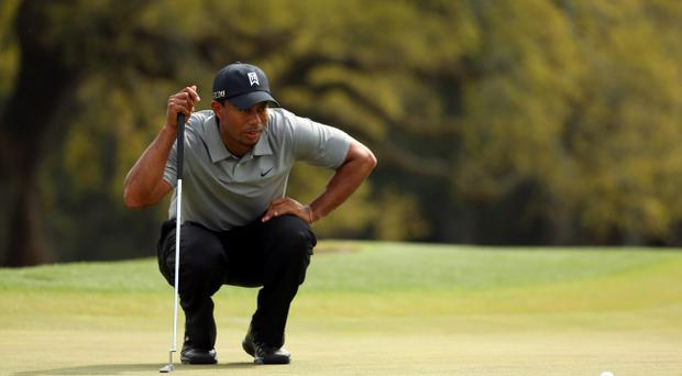 AUGUSTA, GA - APRIL 11: Tiger Woods of the United States lines up a putt on the 18th hole during the first round of the 2013 Masters Tournament at Augusta National Golf Club on April 11, 2013 in Augusta, Georgia. (Photo by Mike Ehrmann/Getty Images)