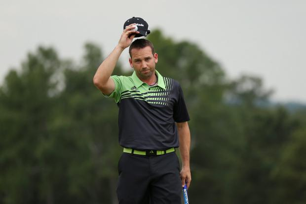 AUGUSTA, GA - APRIL 11: Sergio Garcia of Spain reacts on the 18th hole during the first round of the 2013 Masters Tournament at Augusta National Golf Club on April 11, 2013 in Augusta, Georgia. (Photo by Mike Ehrmann/Getty Images)