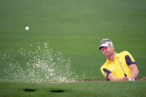 AUGUSTA, GA - APRIL 11: David Lynn of England hits out of the bunker on the second hole during the first round of the 2013 Masters Tournament at Augusta National Golf Club on April 11, 2013 in Augusta, Georgia. (Photo by Harry How/Getty Images)