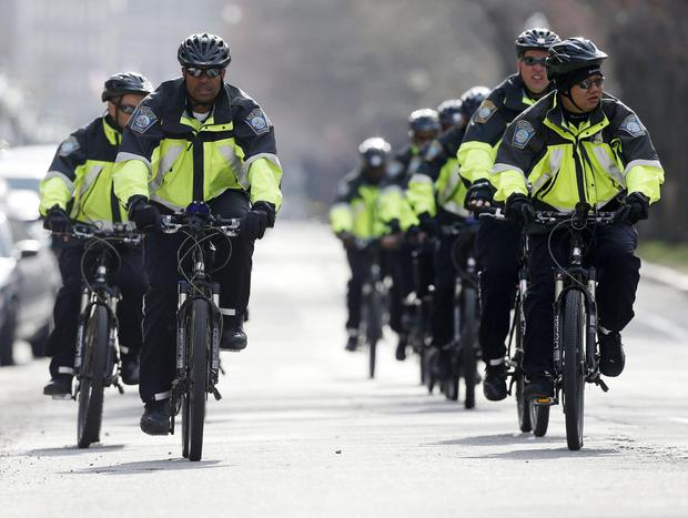 Boston police on bicycles patrol on Commonwealth Avenue