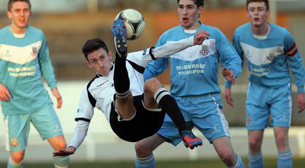 Lisburn Distillery's Jordan Forsythe goes airborne during Tuesday night's Danske Bank Premiership game at Ballyskeagh