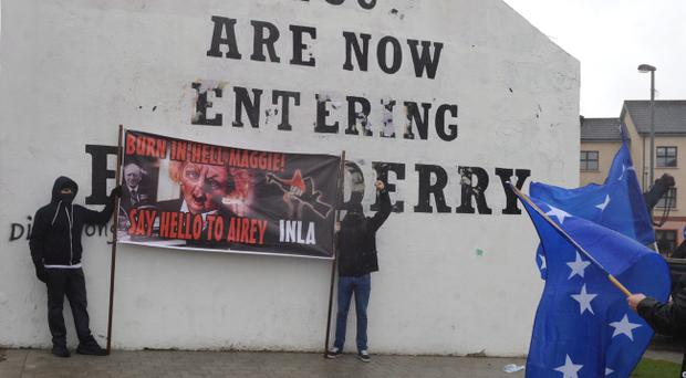 Derry Republicans hold a protest in the Bogside area on Wednesday, on the day of Margaret Thatcher