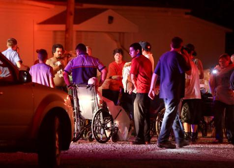 Elderly persons from a nearby nursing home are triaged in a parking lot before being moved to a school stadium following a fertilizer plant explosion Wednesday, April 17, 2013, in West, Texas. The explosion near Waco Wednesday night injured dozens of people and sent flames shooting high into the night sky, leaving the factory a smoldering ruin and causing major damage to surrounding buildings. (AP Photo/Waco Tribune Herald, Rod Aydelotte)