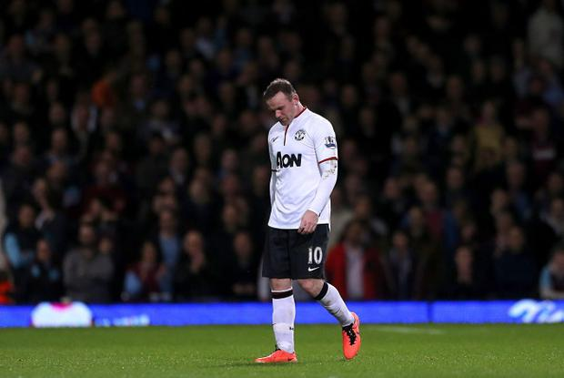 Manchester United's Wayne Rooney looks dejected during the Barclays Premier League match at Upton Park, London