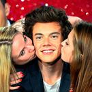 Jodie Wells and Ruby Yeomans (right) both 16 and from Essex, get to kiss Harry Styles and meet their idols from the band One Direction up close, as the band are presented to the world, but only in wax form at Madame Tussauds in central London