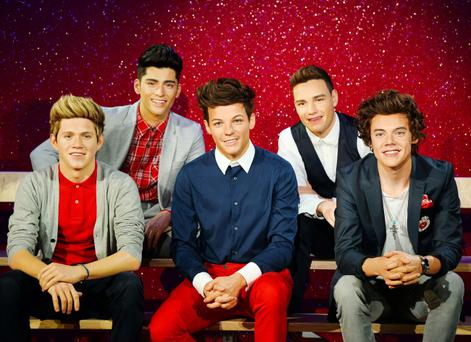 The band One Direction were presented to the world, but only in wax form at Madame Tussauds in central London
