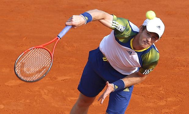 Andy Murray of Great Britain serves the ball to Edouard Roger Vasselin of France during their match of the Monte Carlo Tennis Masters tournament in Monaco, Wednesday, April 17, 2013. (AP Photo/Lionel Cironneau)