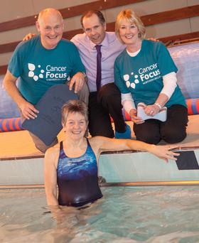 (L-r) Sam Ware, Cancer Focus NI; Ards Leisure Centre Manger, Ian O'Neill; Joan Emery, Cancer Focus NI, and in the pool, cancer survivor, and swim challenge participant Ann Tweedie