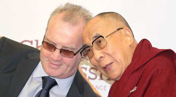 The Dalai Lama and Richard Moore of Children In Crossfire crossing the Peace Bridge in Derry on Thursday