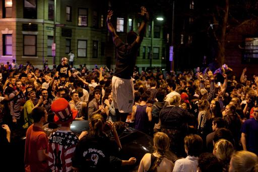 Crowds poured onto a Boston street to celebrate the capture of the second Boston Marathon bombing suspect