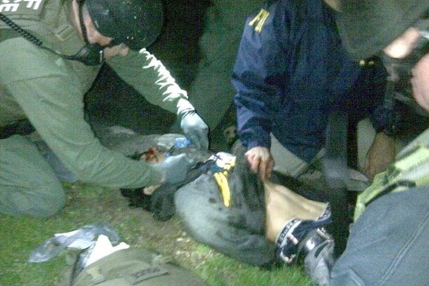 Boston bomber suspect caught and wounded after being discovered hiding in a boat behind a house