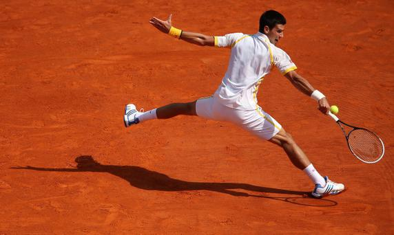 Novak Djokovic of Serbia plays a backhand against Rafael Nadal of Spain in their final match during day eight of the ATP Monte Carlo Masters,at Monte-Carlo Sporting Club on April 21, 2013 in Monte-Carlo, Monaco
