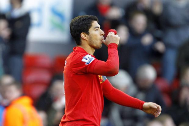 Liverpool's Luis Suarez celebrates scoring his team's second goal against Chelsea during yesterday's Barclays Premier League match at Anfield