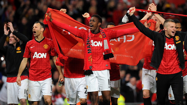 Manchester United's Danny Welbeck (centre), Ryan Giggs and Tom Cleverley (right) celebrate the club's 20th league title after the final whistle during the Barclays Premier League match at Old Trafford, Manchester