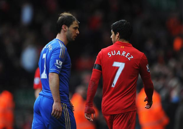 LIVERPOOL, ENGLAND - APRIL 21: Branislav Ivanovic of Chelsea talks with Luis Suarez of Liverpool as they walk in for half time during the Barclays Premier League match between Liverpool and Chelsea at Anfield on April 21, 2013 in Liverpool, England. (Photo by Michael Regan/Getty Images)