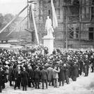 Belfast City Hall. Donegall Square. Under construction in 1903. The Earl of Glasgow unveiling the statue of Sir Edward J Harland in the grounds of the new City Hall.