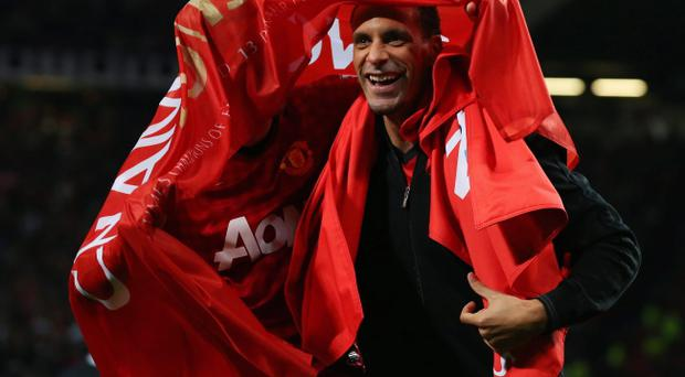 MANCHESTER, ENGLAND - APRIL 22: Michael Carrick (L) and Rio Ferdinand of Manchester United celebrate winning the Premier League title after the Barclays Premier League match between Manchester United and Aston Villa at Old Trafford on April 22, 2013 in Manchester, England. (Photo by Alex Livesey/Getty Images)