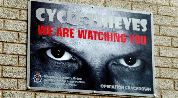 The signs that Newcastle University have put up around their campus of a pair of eyes, which has lowered the number of bike thefts