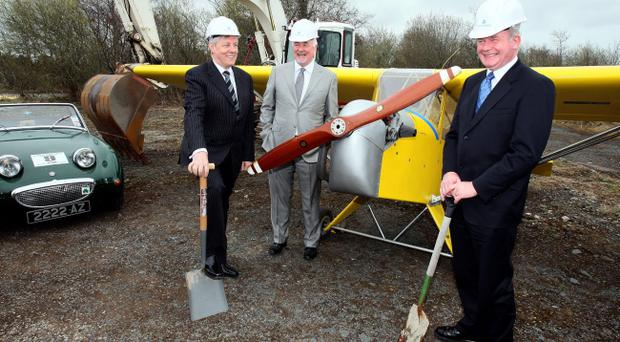 First Minister Peter Robinson (left) and Deputy First Minister Martin McGuinness (right) with Chairman of the corporation behind the development of the Maze site, Terence Brannigan, at a photocall during a press preview on the site of the former Maze prison