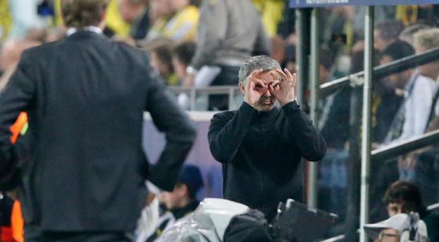 Real Madrid's coach Jose Mourinho from Portugal, right, gestures while Dortmund head coach Juergen Klopp, left, looks at him during the Champions League semifinal first leg soccer match between Borussia Dortmund and Real Madrid in Dortmund, Germany, Wednesday, April 24, 2013. (AP Photo/Frank Augstein)