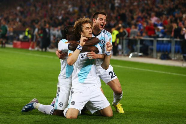 BASEL, SWITZERLAND - APRIL 25: David Luiz (C) of Chelsea celebrates scoring his sides second goal with team mates Victor Moses (L) and Cesar Azpilicueta (R) during the UEFA Europa League Semi Final First Leg match between FC Basel 1893 and Chelsea at St. Jakob Stadium on April 25, 2013 in Basel, Switzerland. (Photo by Clive Rose/Getty Images)