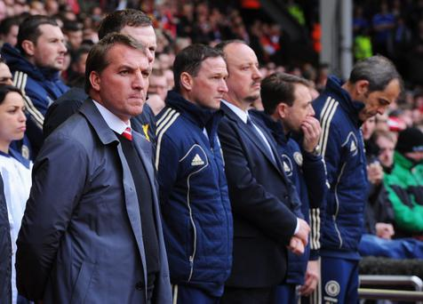 LIVERPOOL, ENGLAND - APRIL 21: Brendan Rodgers (L), manager of Liverpool looks on with Rafael Benitez, interim manager of Chelsea and assistants prior to the Barclays Premier League match between Liverpool and Chelsea at Anfield on April 21, 2013 in Liverpool, England. (Photo by Michael Regan/Getty Images)