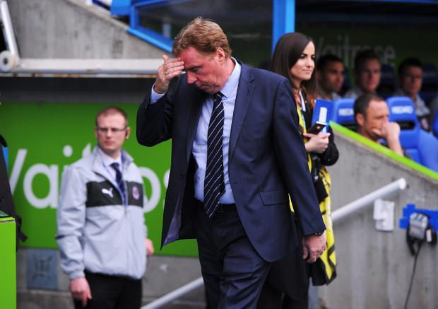 READING, ENGLAND - APRIL 28: Harry Redknapp, manager of Queens Park Rangers wipes his brow prior to the Barclays Premier League match between Reading and Queens Park Rangers at the Madejski Stadium on April 28, 2013 in Reading, England. (Photo by Michael Regan/Getty Images)
