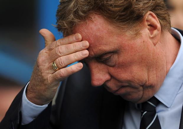 Queens Park Rangers Manager Harry Redknapp takes his seat in the dugout before the Barclays Premier League match at the Madejski Stadium, Reading