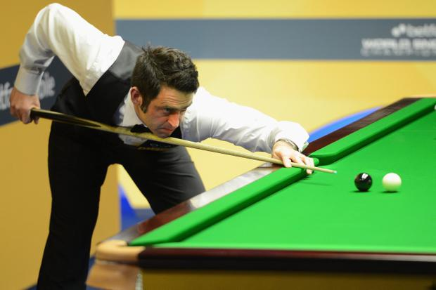 SHEFFIELD, ENGLAND - APRIL 29: Ronnie O'Sullivan of England plays a shot in his match against Allister Carter of England during the Betfair World Snooker Championship at the Crucible Theatre on April 29, 2013 in Sheffield, England. (Photo by Michael Regan/Getty Images)