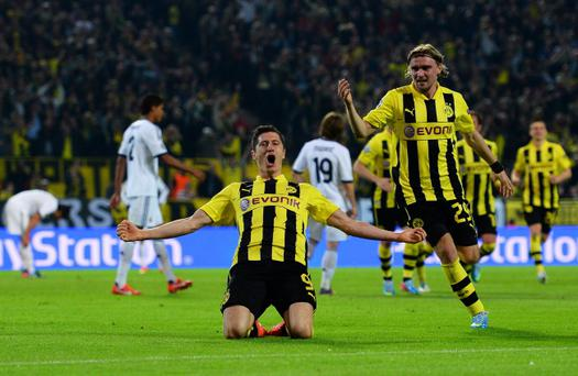 DORTMUND, GERMANY - APRIL 24: Robert Lewandowski of Borussia Dortmund celebrates after scoring his team's third goal during the UEFA Champions League semi final first leg match between Borussia Dortmund and Real Madrid at Signal Iduna Park on April 24, 2013 in Dortmund, Germany. (Photo by Lars Baron/Bongarts/Getty Images)