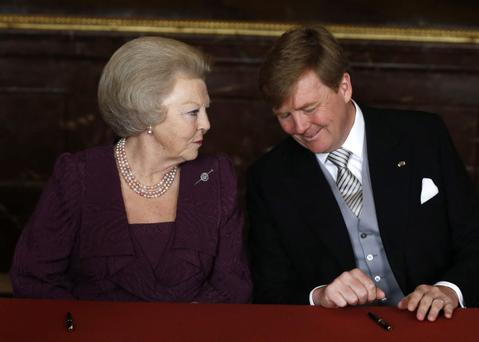 Prince Willem-Alexander of the Netherlands sits alongside his mother Queen Beatrix of the Netherlands during her abdication ceremony in the Moseszaal at the Royal Palace on April 30, 2013 in Amsterdam