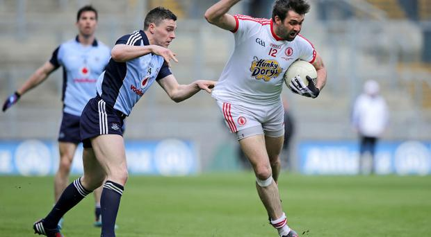 Joe McMahon was left to pick the Tyrone players up after their narrow defeat to Dublin