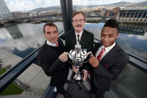 Liverpool manager Brendan Rodgers at the 2013 Milk Cup draw at w5 inside the Odyssey complex Belfast alongside Victor Leonard and Liverpool winger Rahim Sterling
