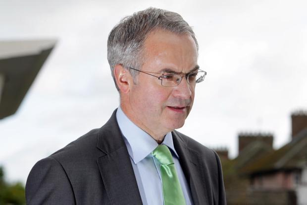 Environment Minister Alex Attwood has vowed to get tough on problem property developers whose sites become eyesores