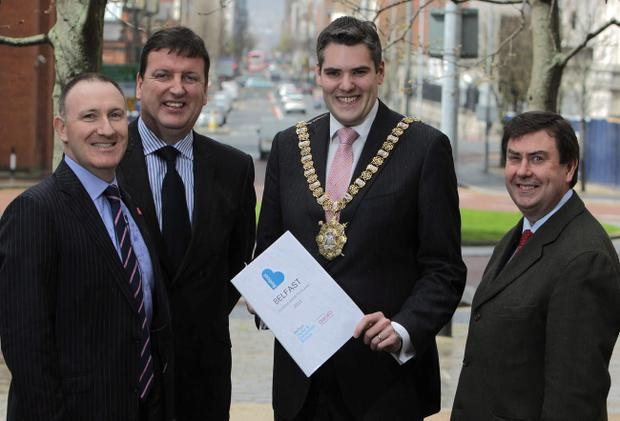 Belfast's Lord Mayor, Alderman Gavin Robinson, as he is joined by Gerry Lennon (left), chief executive of Belfast Visitor and Convention Bureau (BVCB), Paddy McKenna, commercial manager, Diageo NI, and BVCB chair Ciaran Rogan (far right) after BVCB presented the plans to members from Belfast's tourism, hospitality and retail sectors
