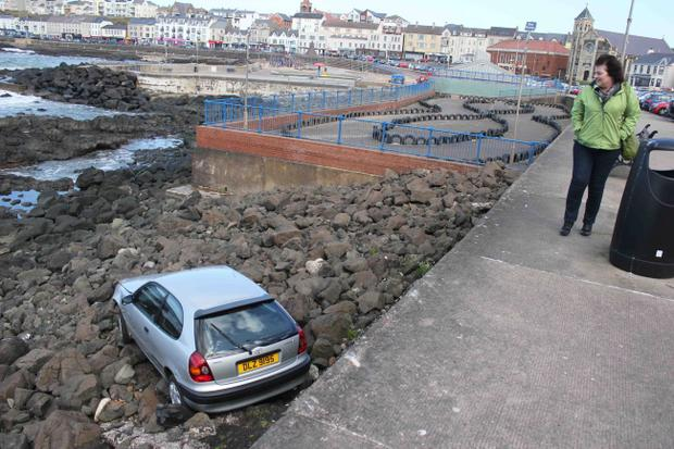 A couple in there nineties had a lucky escape when their car left the Crescent and landed on the rocks in Portstewat on Wednesday afternoon. The eldery couple had to be treated in The Causeway Hospital. PICTURE MARK JAMIESON.