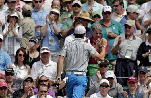 Rory McIlroy holds up his ball after putting on the sixth green during the second round of the Masters golf tournament Friday, April 12, 2013, in Augusta, Ga. (AP Photo/Charlie Riedel)