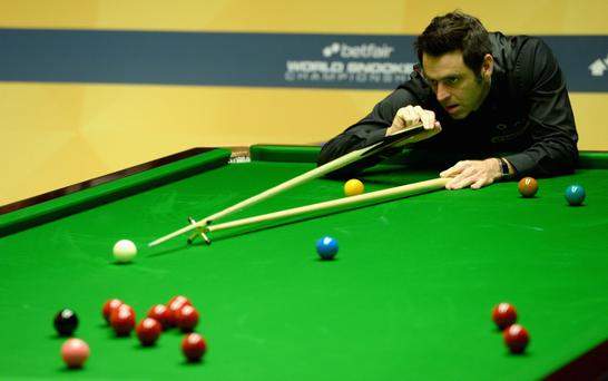 SHEFFIELD, ENGLAND - MAY 01: Ronnie O'Sullivan plays a shot against Stuart Bingham during their Quarter Final match in the Betfair World Snooker Championship at the Crucible Theatre on May 01, 2013 in Sheffield, England. (Photo by Gareth Copley/Getty Images)