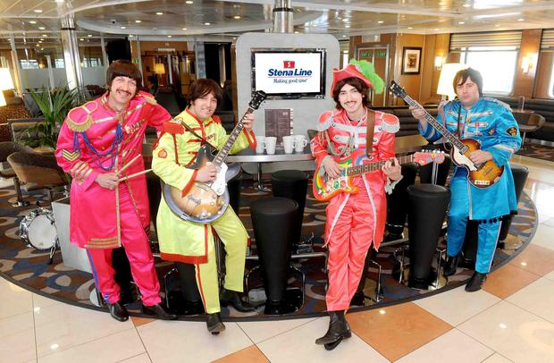 Ticket to cruise: Stena Line has invested £4.6m on its Belfast to Liverpool ferries. Pictured on board are Liverpool's finest, the Cabin Beatles.