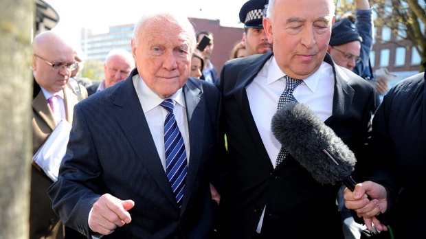 Veteran BBC broadcaster Stuart Hall, with solicitor Maurice Watkins, leaves Preston Crown Court after it was announced that he has admitted indecently assaulting 13 girls, the youngest aged nine