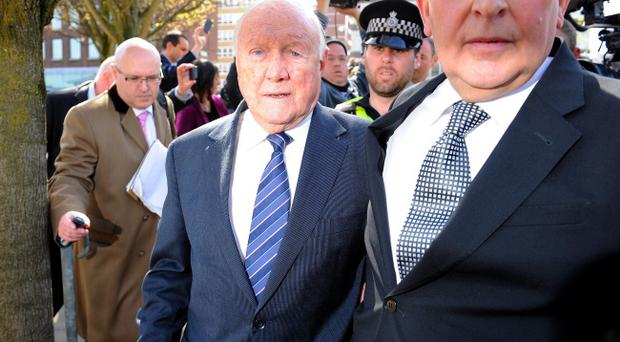 Veteran BBC broadcaster Stuart Hall, with solicitor Maurice Watkins, leaves court after it was announced that he has admitted indecently assaulting 13 girls, the youngest aged nine